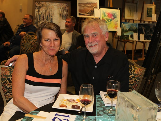 Kris and Charlie Foust surrounded by art at the DAC