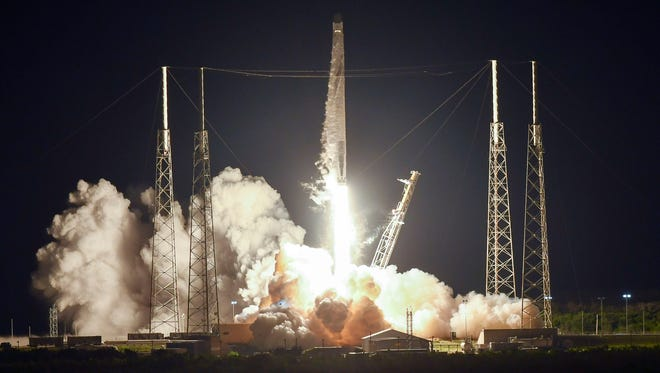 A SpaceX Falcon 9 rocket lifts off from Cape Canaveral Air Force Station. The rocket is carrying cargo to the International Space Station.