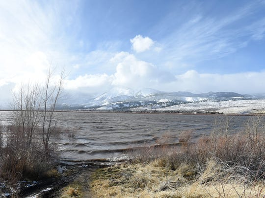 Andy Barron/RGJ Little Washoe Lake is full again on Wednesday after the recent rain storm.