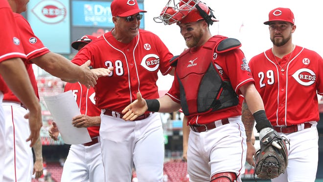 Cincinnati Reds manager Bryan Price (38) and catcher Tucker Barnhart (16) celebrate beating the San Diego Padres, 3-0, at Great American Ball Park Sunday, June 26, 2016.