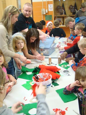 Stratford kindergarten and high school PALS students work together during a holiday craft.project