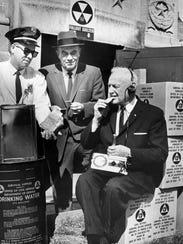 Mayor Albert Losche (right) takes a bite of a survival