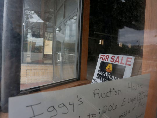 """A """"for sale"""" sign sits in the former location of Iggy's"""
