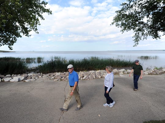 Barbara and Mark Redmond of DePere walk past the former swimming beach area at Bay Beach Amusuement Park.