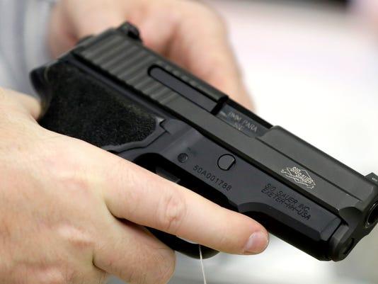 AP OBAMA GUNS A USA TX