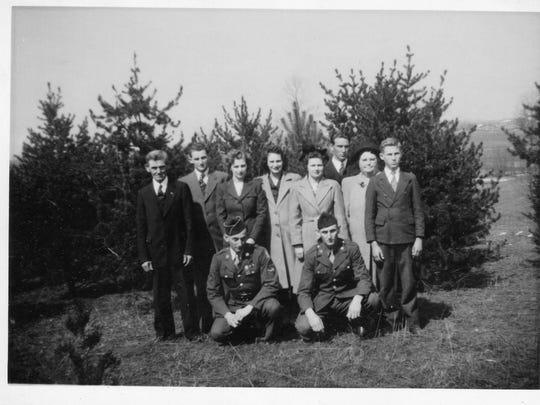 Part of the Merkley family. Kneeling in front left is Arthur Merkley, and on the right Clarence Merkley.