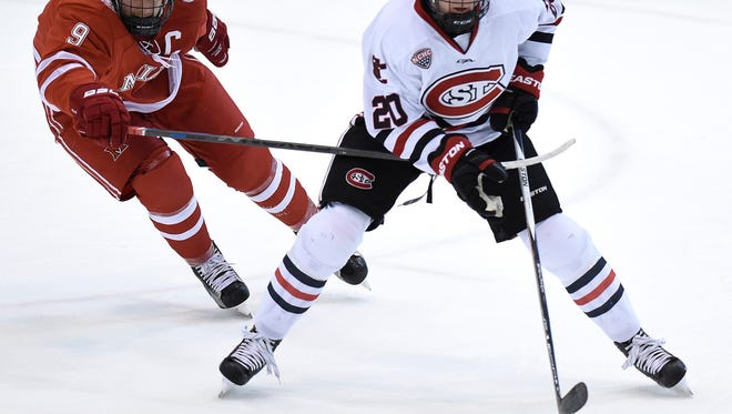 St. Cloud State defenseman Will Borgen (20) tries to get past Miami's Sean Kuraly during a game at the Herb Brooks National Hockey Center. Monday, Borgen was one of 29 players named to the preliminary Team USA roster to play in the IIHF World Junior Championships.