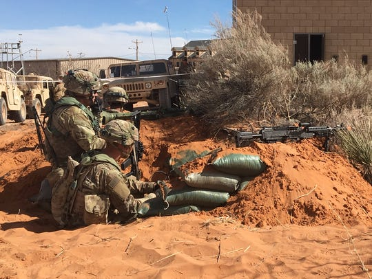 Soldiers prepare to defend a village in the Fort Bliss