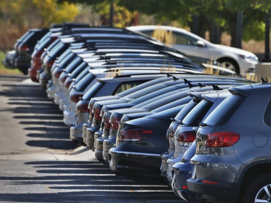 Volkswagen vehicles for sale are on display on the lot of a VW dealership in Boulder, Colo. (AP Photo/Brennan Linsley, File)