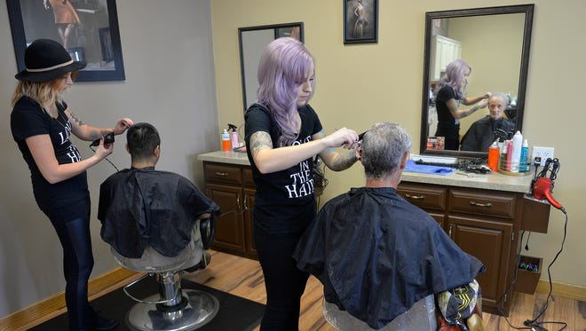 Stylist Amy Revier, right, cuts Place of Hope resident Ben Margiotta's hair as fellow stylist Marissa Haus, left, works on another haircut Sunday, May 22, at Headlines Salon & Spa in Sartell.