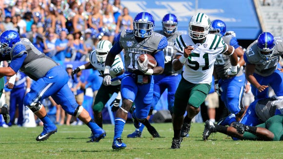 Boom Williams scores on a 53-yard touchdown run against Ohio, Saturday, Sept. 06, 2014, at Commonwealth Stadium in Lexington.