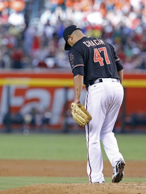 Arizona Diamondbacks starting pitcher Jhoulys Chacin (47) reacts after giving up a two-run home run against  the Oakland Athletics  in the second inning of their MLB game Saturday,  August 29, 2015 in Phoenix, Ariz.