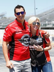 IndyCar driver Graham Rahal laughs with his wife Courtney Force, NHRA's winningest female driver, during a racing skills challenge in Sonoma, Calif., last year.