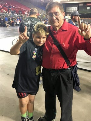 Luke Sandoval from Team Silver joined forces with his old coach Ruben Udero from the Cobre Youth Wrestling Team and won a first place trophy from the Edge of Texas National Tournament.