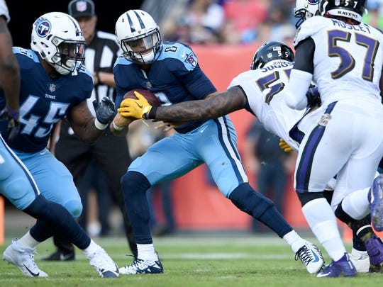 Titans quarterback Marcus Mariota (8) is sacked by Ravens linebacker Terrell Suggs (55) during the third quarter at Nissan Stadium Sunday, Nov. 5, 2017 in Nashville, Tenn.