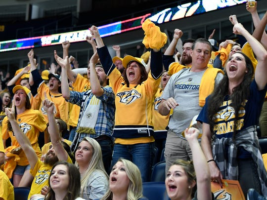 Predators fans celebrate a Nashville goal during the first period of a Game 4 watch party for the second round NHL Stanley Cup Playoffs between the Nashville Predators  and the Winnipeg Jets at Bridgestone Arena Thursday, May 3, 2018, in Nashville, Tenn.