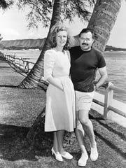 Martha Gellhorn with Ernest Hemingway on Waikiki in