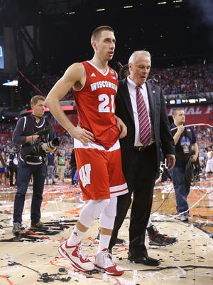 Wisconsin Badgers guard Josh Gasser and Wisconsin Badgers head coach Bo Ryan walk off the court after losing to Duke 68-63 in the NCAA Championship game at Lucas Oil Stadium on Monday, April 6, 2015.