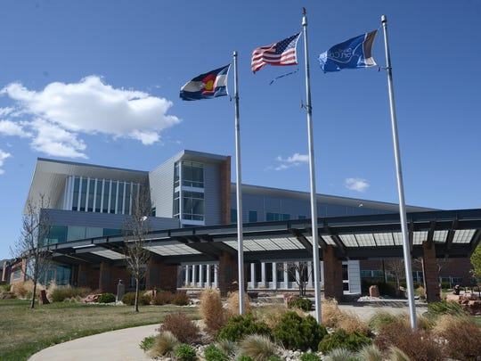 Winds that whipped the flags at Fort Collins Police Services headquarters this week are expected to subside as daytime high temperatures reach into the 80s this weekend.