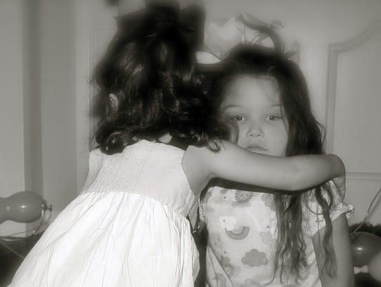 "Kylie Bush hugs her ""transplant sister"" Ashley-Kate"