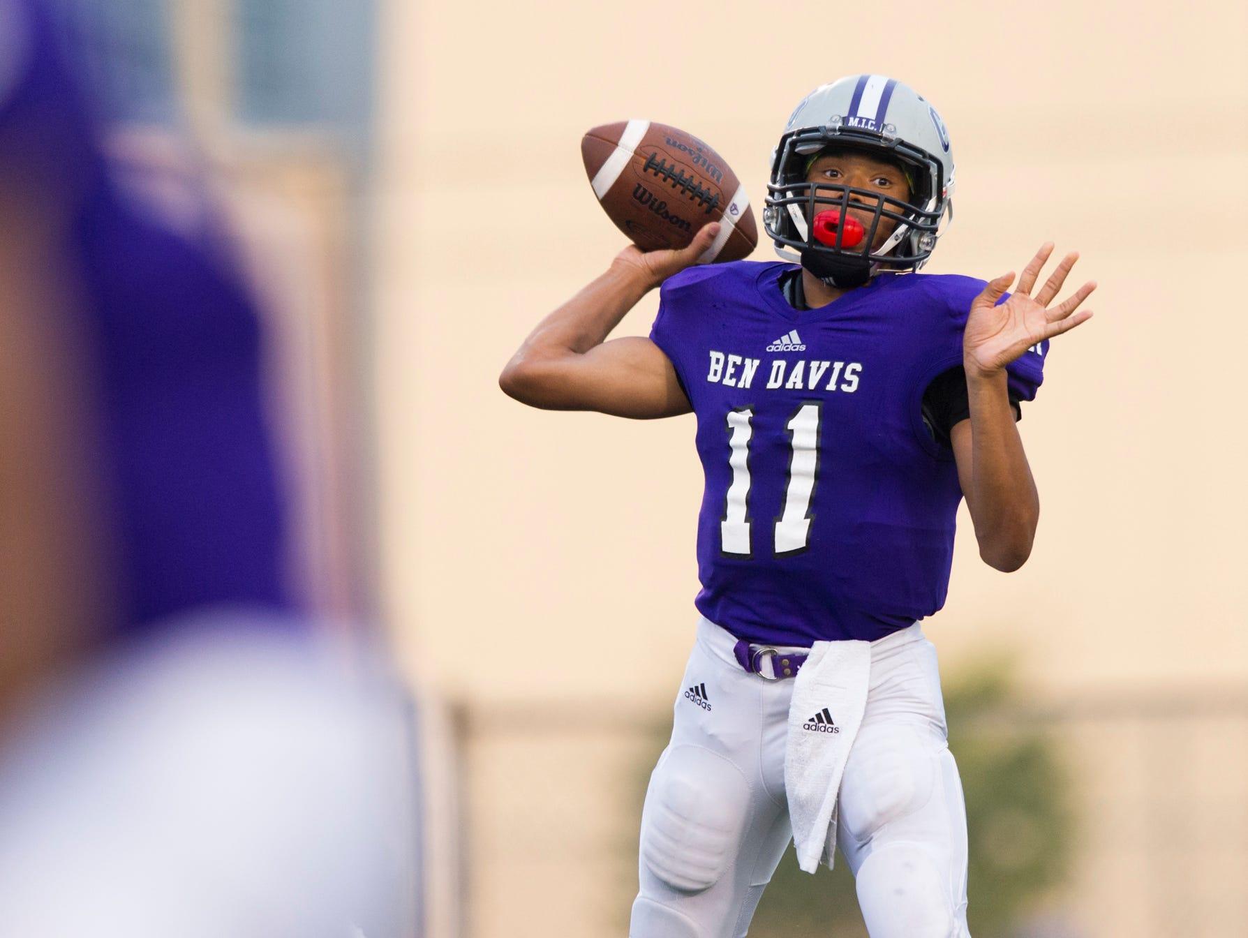 Ben Davis High School sophomore Reese Taylor (11) draws back to make a pass during first-half action of a IHSAA varsity football game at Ben Davis High School, Friday, September 18, 2015.