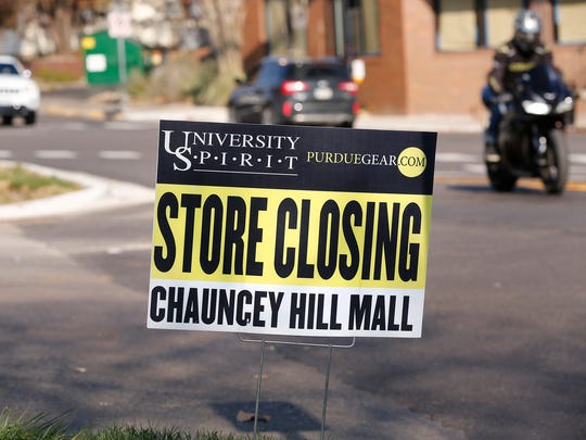 Signs posted around Chauncey Hill Mall annouce the