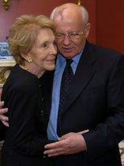 Former Soviet General Secretary Mikhail Gorbachev embraces Nancy Reagan during their visit at the Blair House in Washington, D.C. on June 10, 2004.