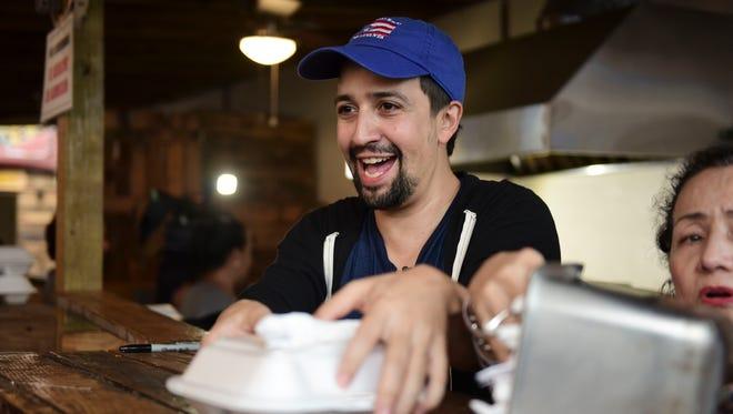 Actor and composer of Puerto Rican descent Lin Manuel Miranda distributes food to victims of Hurricane Maria in La Placita de Güisin, in Vega Alta, Puerto Rico, Tuesday, Nov. 7, 2017.