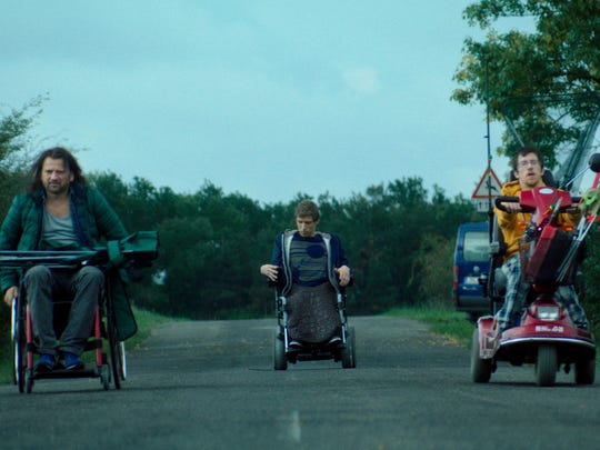 "Two wheelchair-bound teenagers find their calling working with a disabled hit man in ""Kills on Wheels."""