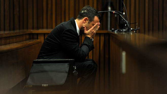 Olympic and Paralympic track star Oscar Pistorius reacts during the fourth day of his trial for the murder of his girlfriend Reeva Steenkamp at the North Gauteng High Court in Pretoria, March 6, 2014.
