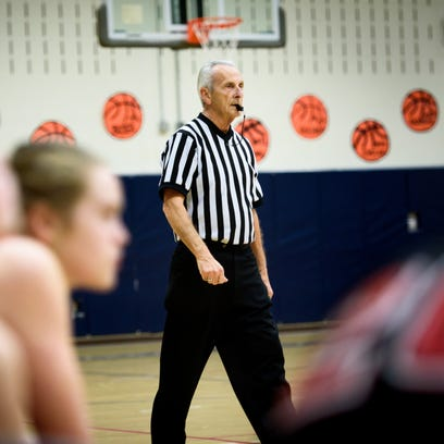 Longtime PIAA referee Don Middleton strolls down the