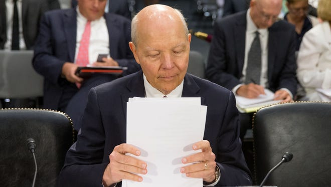 IRS Commissioner John Koskinen prepares July 29, 2015, before the Senate to testify on Capitol Hill in Washington, D.C.