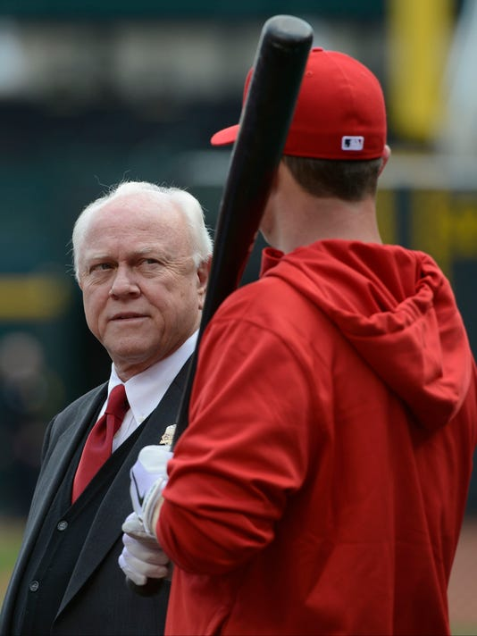 FILE - In this Monday, April 1, 2013  file photo, Cincinnati Reds general manager Walt Jocketty talks with Cincinnati Reds right fielder Jay Bruce prior to a major league baseball game against the Los Angeles Angels in Cincinnati. Dave Dombrowski and Walt Jocketty made a trade Thursday morning, Dec. 11, 2014. Dombrowski's Detroit Tigers acquired pitcher Alfredo Simon from Jocketty's Cincinnati Reds for a pair of young players.(AP Photo/Michael Keating, File)