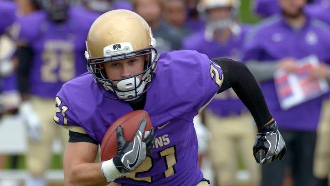 Albion College receiver Collin Poore (21).