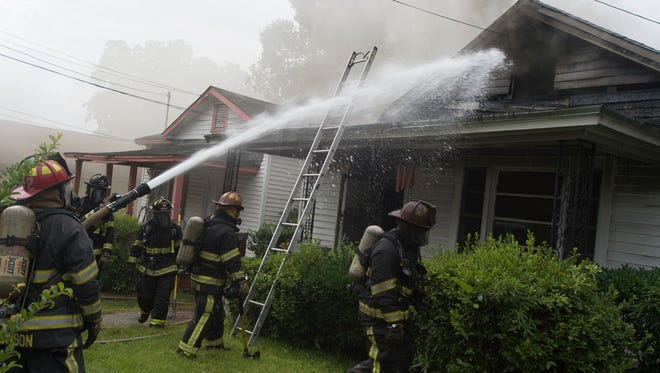 Montgomery firefighters work the scene of a fire at 918 Grove St. in Montgomery, Ala., on Tuesday, June 30, 2015. Firefighters also responded to a call a block away at the same time in the 1000 block of Hutchinson Street.