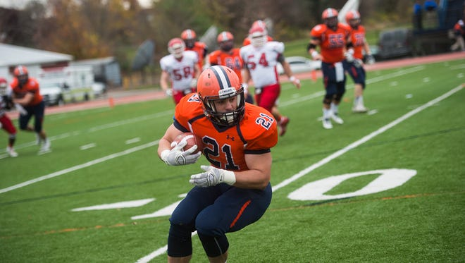 Gettysburg's Kyle Wigley turns around after catching a pass against Dickinson on Saturday at Musselman Stadium. Gettysburg moved to 6-3 on the season following its 20-17 victory.