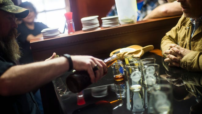 Owner Dan Kulick of Battlefield Brew Works pours a sample of Spirits of Gettysburg Distillery whiskey for a customer. The Brew Works and Distillery are part of the Adams County Pour Tour.