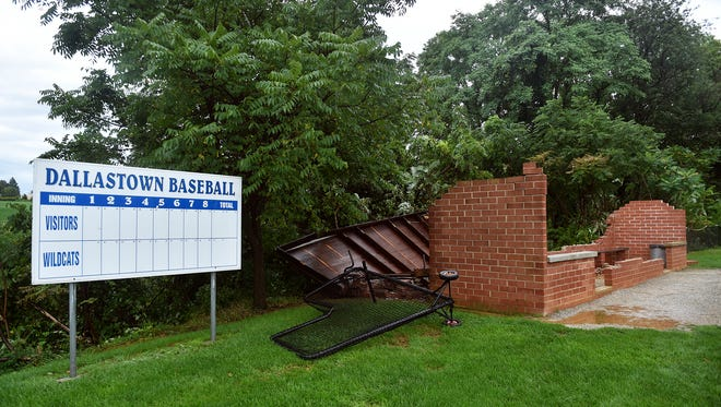 Dallastown baseball's home dugout is shown in pieces after an afternoon storm Friday, Aug. 18, 2017. Parents reported seeing lightning strike the baseball field, but assistant coach and maintenance employee Corey Knaub said the damage resembled the aftermath of tornado-like activity.