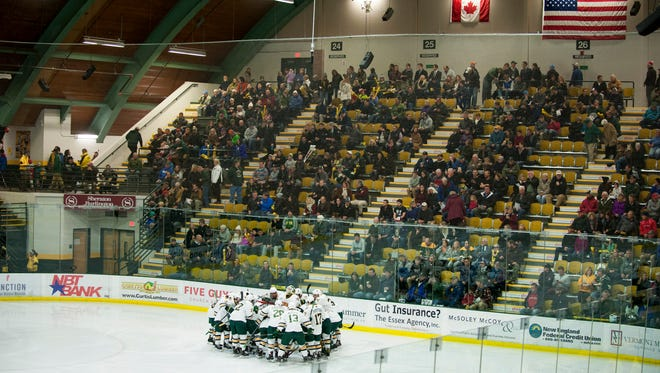 Vermont huddles together during the men's hockey game between the Boston College Eagles and the Vermont Catamounts at Gutterson Field House on Friday night November 10, 2017 in Burlington.