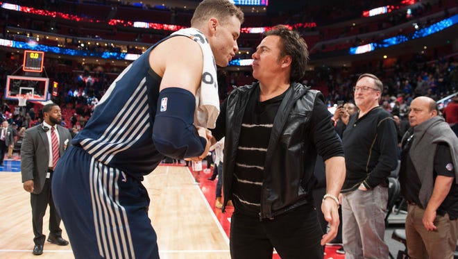 Detroit Pistons forward Blake Griffin (23) talks to owner Tom Gores after the game against the Chicago Bulls at Little Caesars Arena on Friday, March 9, 2018.