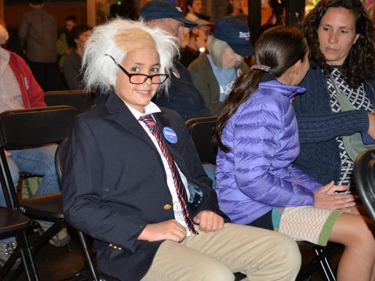 Angus O'Neil-Dunne, 9, of Burlington put on his Bernie Sanders costume to attend the Democratic debate watch party at ArtsRiot in Burlington Tuesday night. To his right are his sister, Alisa, 11, and mother, Julie Hathaway.