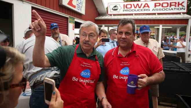 New Jersey Gov. Chris Christie meets with Iowa Gov. Terry Branstad at the Iowa Pork producers tent at the Iowa State Fair on Saturday, Aug. 22, 2015, in Des Moines, Iowa.
