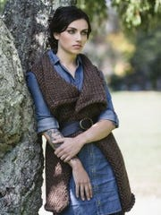 "This vest is the Time Travelor's Vest from ""Highland Knits."" It's reversible."