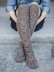 "Stay warm all winter with these Standing Stone Stockings from ""Highland Knits."""