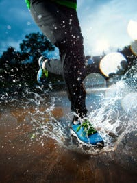 Single runner running in rain (Courtesy ThinkStock Photos)