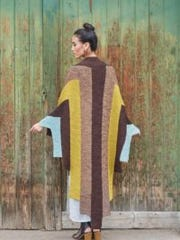 The Apollo Wrap is knitted in Intarsia color blocks.