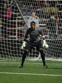 St. John's senior Rafael Diaz is poised to make a save. Photo courtesy Vinny Dusovic/St. John's