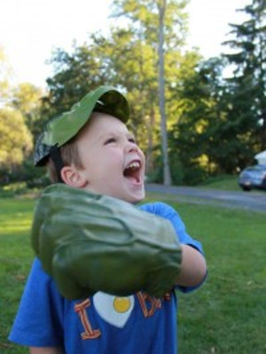 """The would-be kitten, puppy, wolf, or baby bunny--or superhero or monster--who cannot reach out in the roles of their choice and be guided by the dramatic moment at hand, may become silent, or restless, or aggressive and sad. For healthy children, fantasy play is a necessity."" Vivian Gussin Paley (""Tadd as Hulk,"" photo courtesy of Beth Lathrop)"