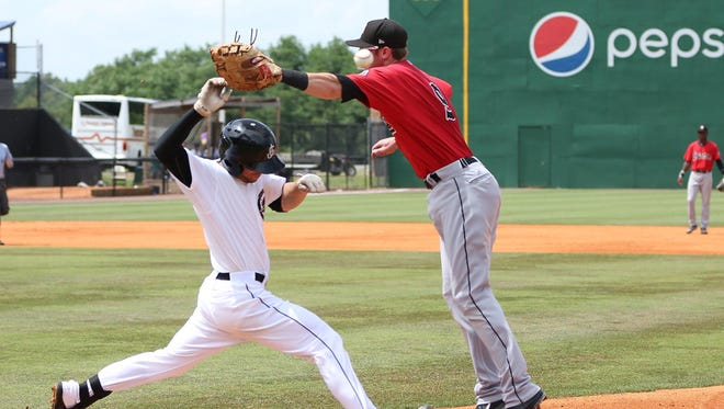 The Jackson Generals' Tyler Smith is safe on the overthrow and eventually makes it to second Sunday afternoon vs. the Birmingham Barons.