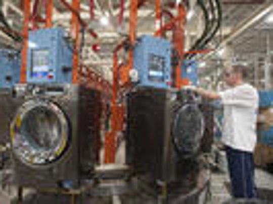 A worker at GE Appliance Park in Louisville works the assembly line. The union is set to vote on a new contract.